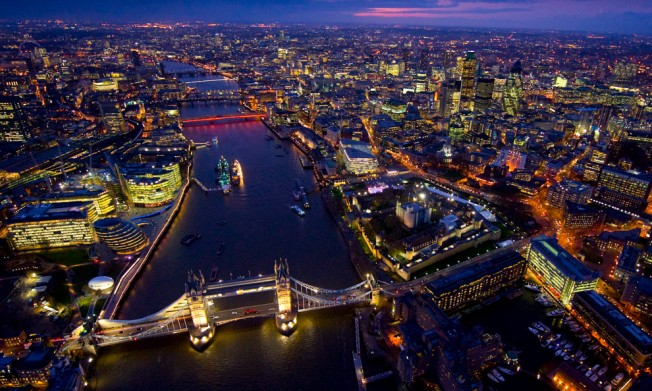 London from the air at night over Tower Bridge